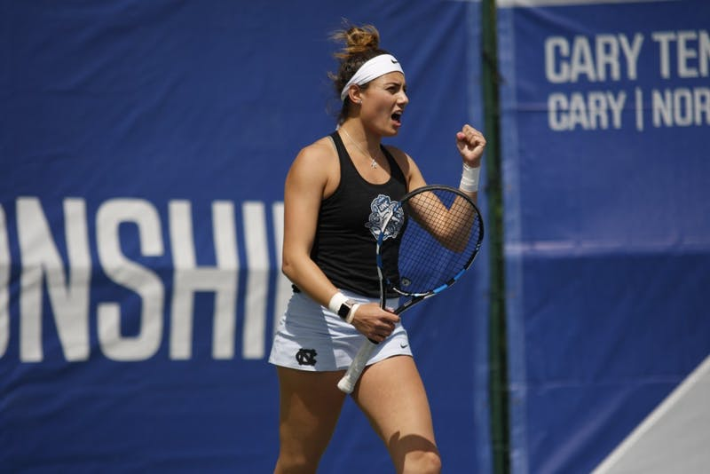 Women's tennis junior Alexa Graham celebrates during her doubles match in the semifinals of the ACC Tournament at Cary Indoor Tennis Park on Saturday, April 20, 2019. UNC beat Miami 4-0.