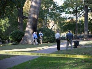 Police investigate an explosion near the Davie Poplar tree in McCorckle Place on Nov. 2.