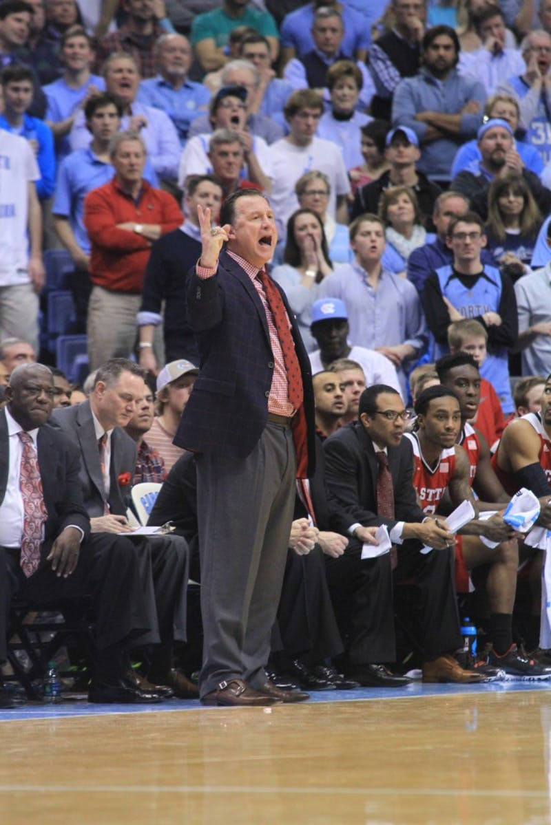 NC State head coach Mark Gottfried instructs his team in the second half as the Wolfpack held off the Tar Heels' run.