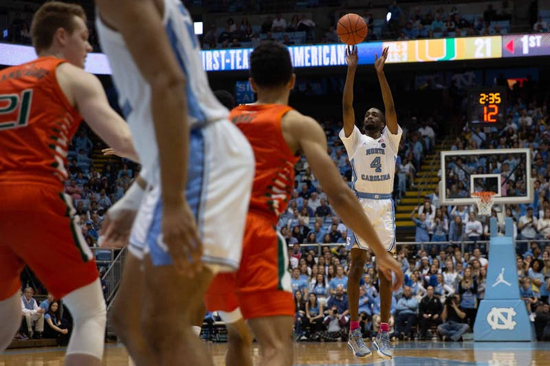UNC senior guard Brandon Robison (4) attempts a three-point shot during a game against Miami in the Smith Center on Saturday, Jan. 25, 2020. UNC defeated Miami 94-71.