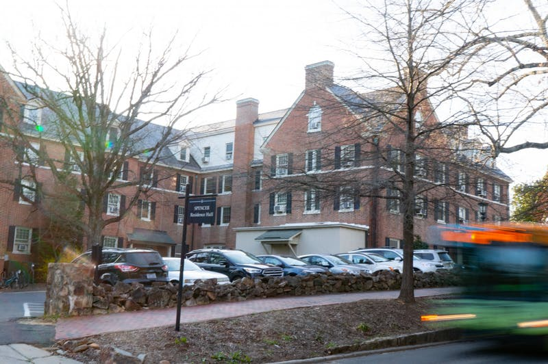 The NU bus slows to a stop at Spencer Residence Hall on Sunday, Mar. 1, 2020. Built in 1924, Spencer was the first all-female residence hall, but is now co-ed.