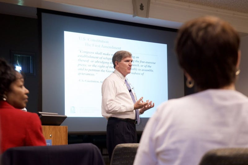 Mark W Merritt, Vice Chancellor and General Counsel, discusses how the First Amendment protects hateful language during a panel discussion Wednesday evening.