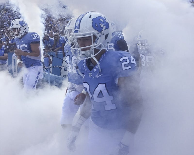 North Carolina defensive back Zach Goins (24) prepares to run out of the smoke filled tunnel. Photo Courtesy of Zach Goins.