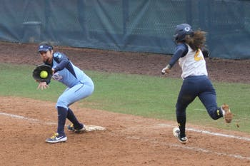 A routine infield hit received by First base Kiersten Licea(1) to get runner  Natalia Rodriguez(21) out to end the game. North Carolina defeated Michigan 4-2 Sunday, February 17th, 2019 at Anderson Softball Stadium in Chapel Hill, North Carolina.