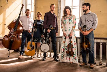 Hank, Pattie & the Current is made up of Jonah Freedman on bass, Billie Feather on guitar, Hank Smith on banjo, Pattie Hopkins Kinlaw on violin and Robert Thornhill on mandolin. On Nov. 22, 2019, the band will be accompanied by four student musicians and perform in Person Hall at 7 p.m. Photo courtesy of Hank Smith.