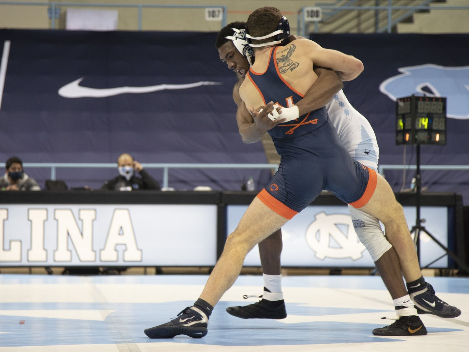 Senior Kennedy Monday wrestles against UVA's Jake Keating in the 165 lbs weight division on senior night in Carmichael Arena on Feb. 13, 2021. Monday lost his match against Keating, however UNC won the match overall, 25-9.