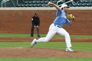 Benton Moss throws a pitch during Sunday's game against Boston College.