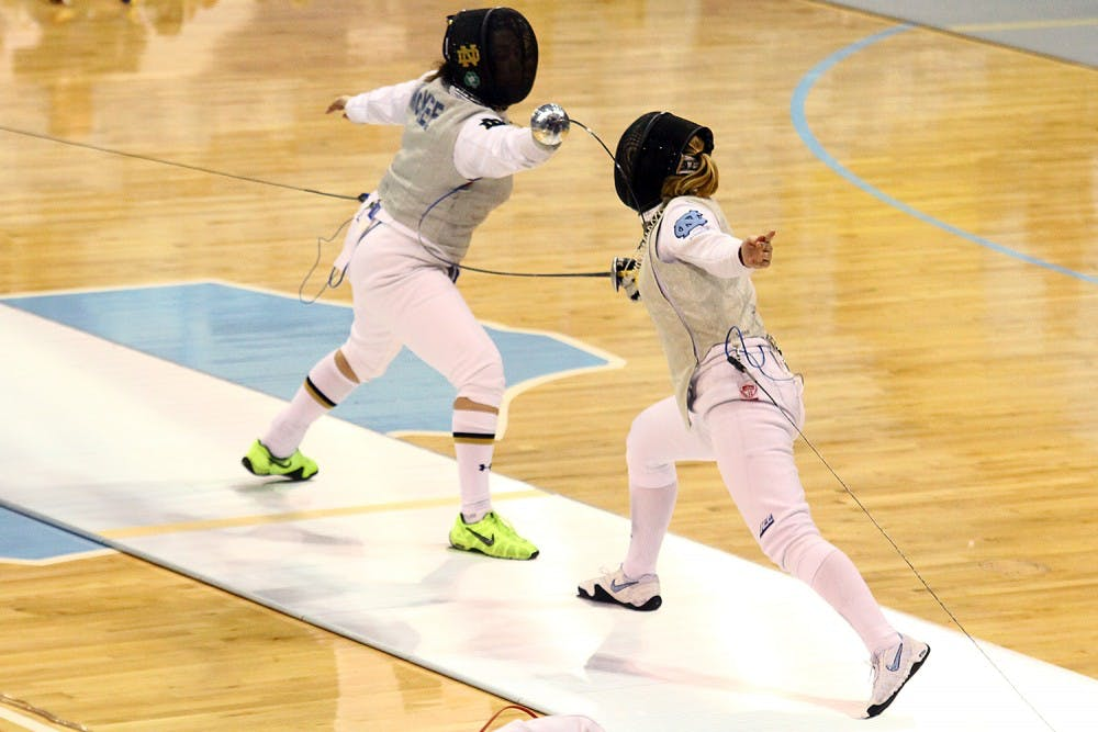 Parker Williams cheers on fencing teammates despite sprained ankle