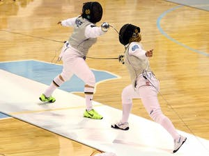 Gabrielle D'Astoli (right) competes in the first ACC Women's Fencing Championship Sunday.