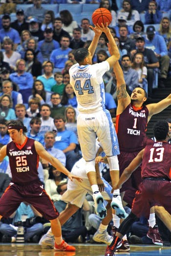 UNC freshman forward Justin Jackson (44) makes a jumper over Virginia Tech freshman guard Malik Müller (1).