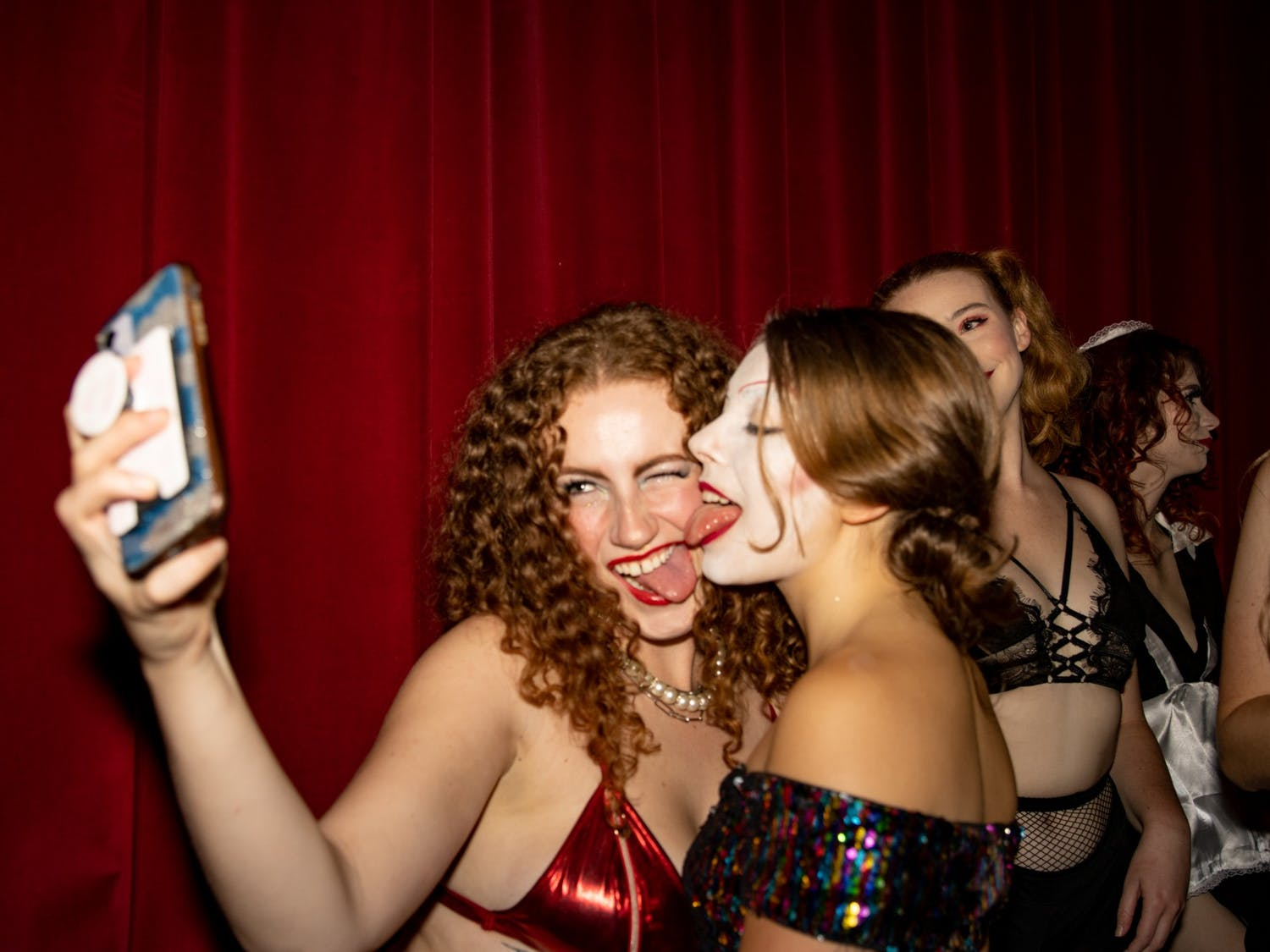 UNC senior Olivia Sullivan and junior Angelina Katsanis take a selfie portraying Dr. Frank-N-Furter and Columbia, respectively, before a technical rehearsal of the Rocky Horror Picture Show on Oct. 26 at the Varsity Theatre. The production is an annual tradition of the UNC Pauper Players.