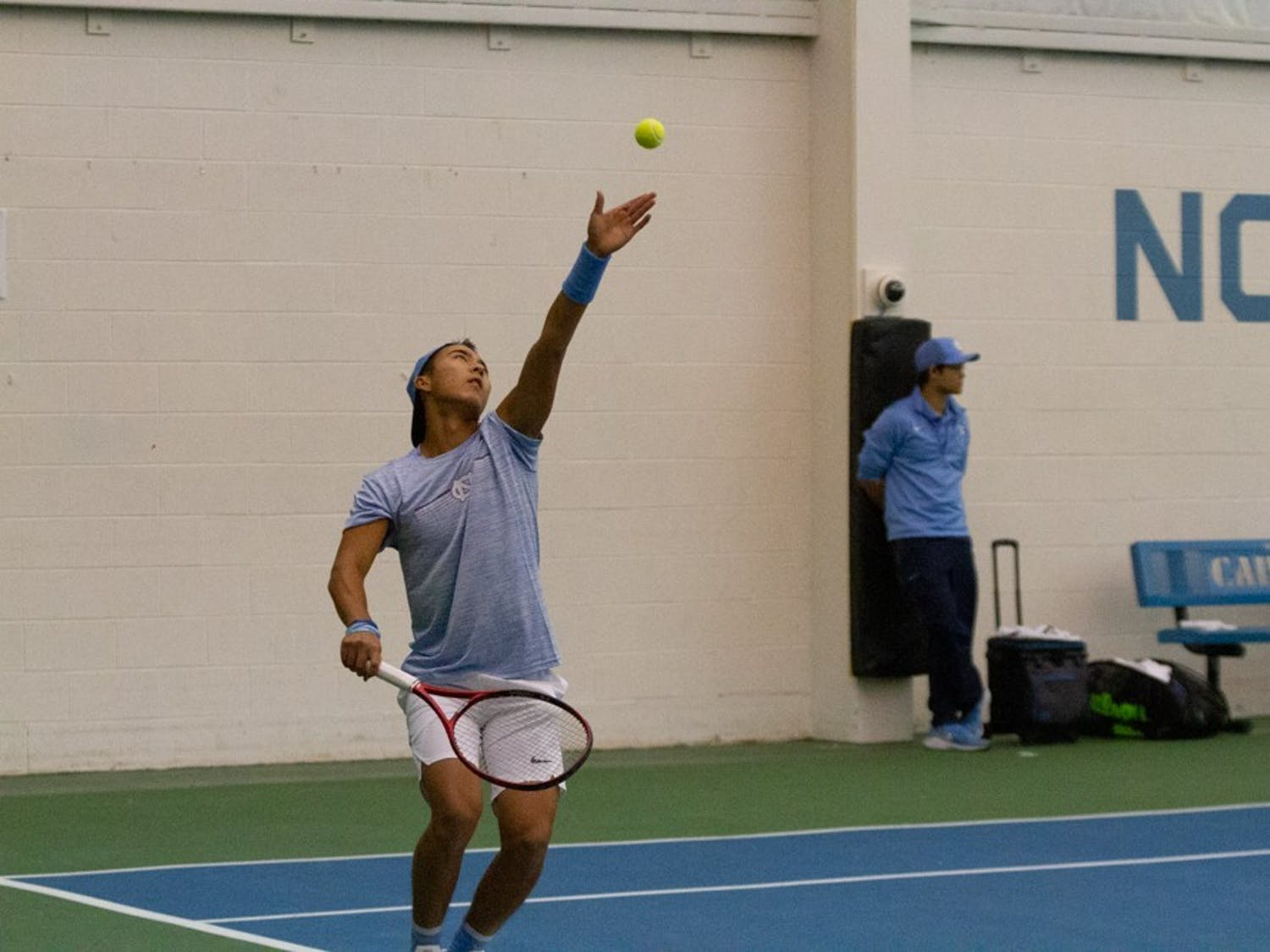 First-year tennis player Rinky Hijikata prepares to serve the ball against Vazha Shubladze and Diego Padilha of Georgia State during men's doubles in the Cone-Kenfield Tennis Center on Sunday, Jan. 26, 2020. Hijikata made his debut on Saturday, Jan. 25, 2020.