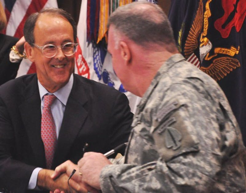 UNC-system President Erskine Bowles, left, and Lt. Gen. John Mulholland Jr. signed an agreement Thursday.