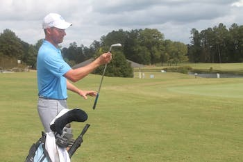 UNC golfer Ben Griffin chooses a club for his next shot during the Tar Heel Intercollegiate Final at Finley Golf Course on Sunday.