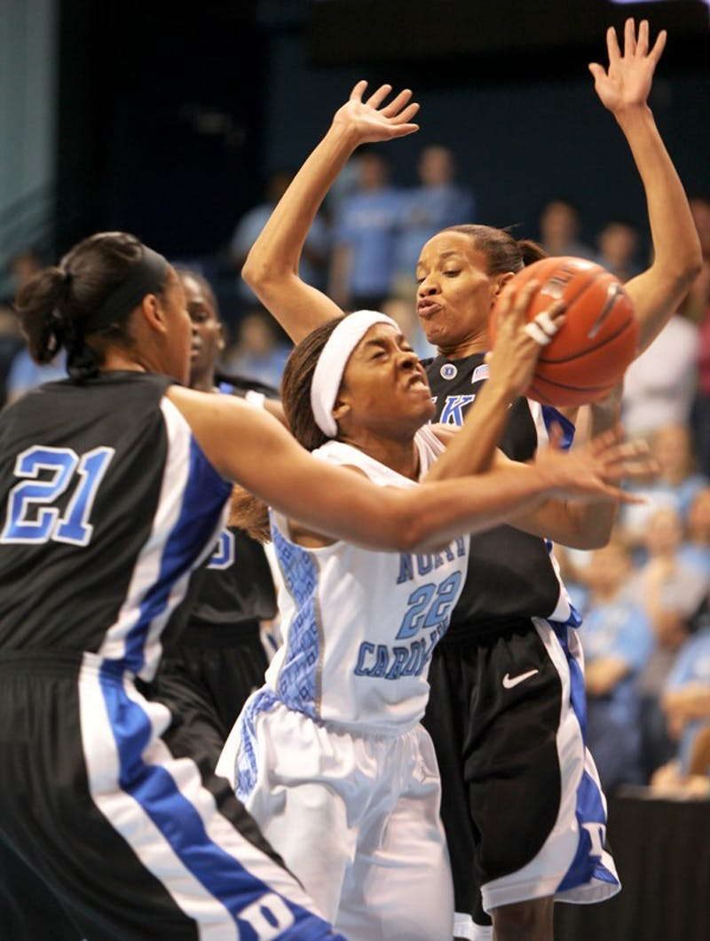 Cetera DeGraffenreid fights through two defenders in Sunday's 64-54 win against Duke. DTH/Phong Dinh