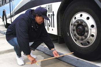 Roxanne Evans of the Triangle Transit judges the passenger stop portion of the Rodeo bus driver obstacle course competition.