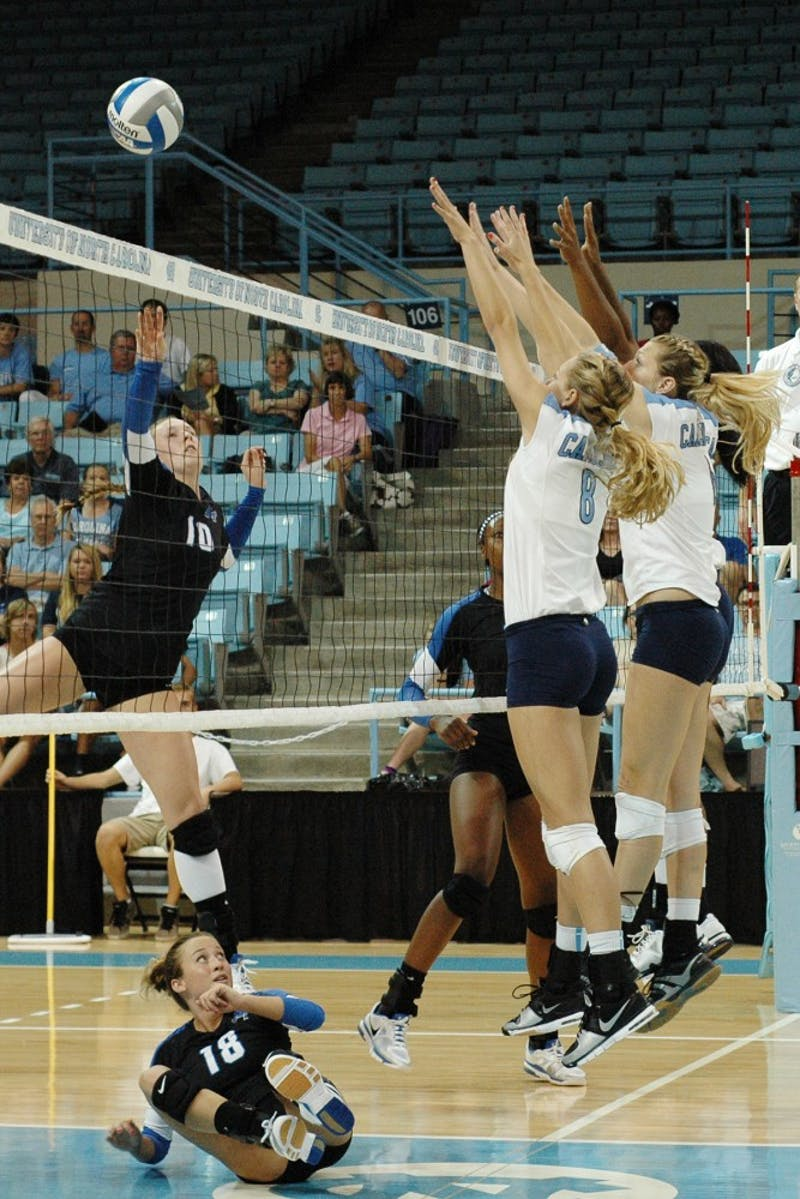 Lauren Adkins, a sophomore from Oviedo, F.L., blocks a set by Middle Tennessee State.