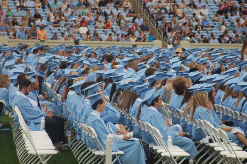 Graduating seniors sit in the crowd during UNC's 2019 spring commencement ceremony.