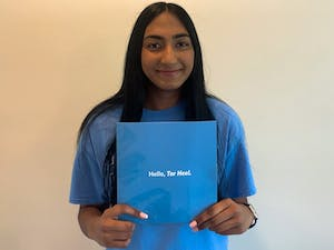 Nikita Umesh poses with her UNC acceptance letter for a virutal portrait in her home on Wednesday, May 26th, 2021. Umesh intends to major in Biology and is excited about the upcoming fall semester.