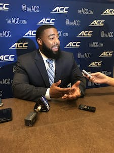 UNC junior defensive tackle Aaron Crawford addresses the media at ACC Kickoff in Charlotte on July 18.