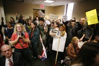 Students storm in after the conclusion of the BOG meeting.