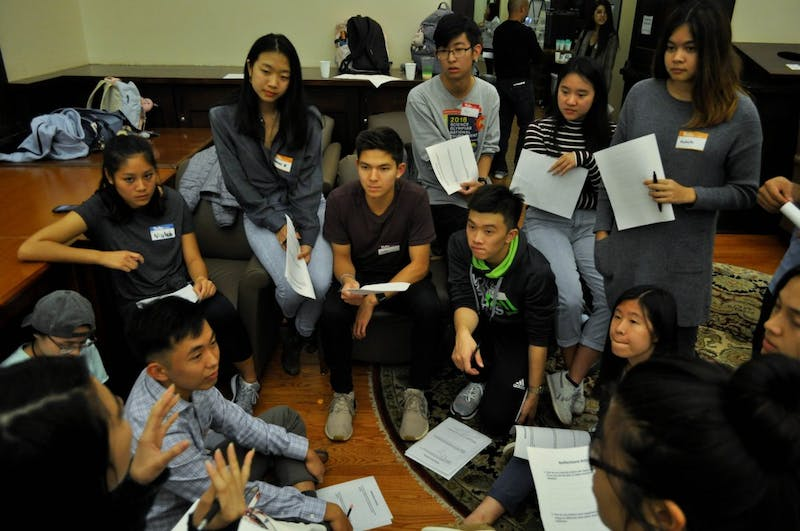 Students participate in a reflection activity during an open forum hosted by the AAC Student Advisory Board at Campus Y's Anne Queen Lounge on Thursday, Oct. 24, 2019. The forum gave attendees the chance to learn about the movement to establish an Asian American Center on campus.