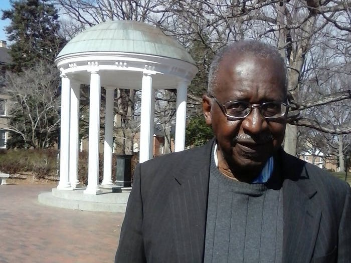 Walter Jackson, '67, pictured in front of UNC's worldwide landmark, the Old Well. Walter Jackson is a member of the UNC Black Pioneers, UNC alumni who marched on Franklin Street during the Civil Rights Movement. Photo courtesy of Walter Jackson.