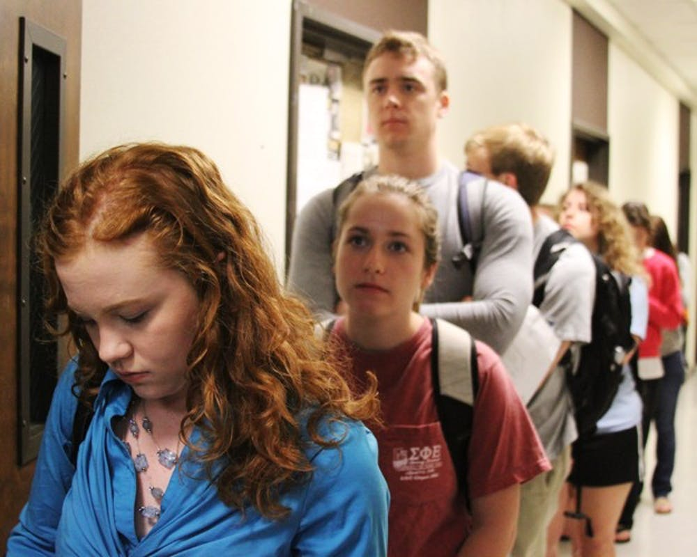 Junior Michelle Austin and other history majors wait outside Hamilton 556 at 7:45 am on Monday morning in hopes of signing up for a required history seminar.