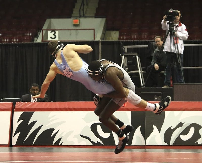 Christian Barber, a UNC wrestler, faces off against Tommy Gantt, a student from North Carolina State University. Gantt won the bout against Barber 10 - 4.