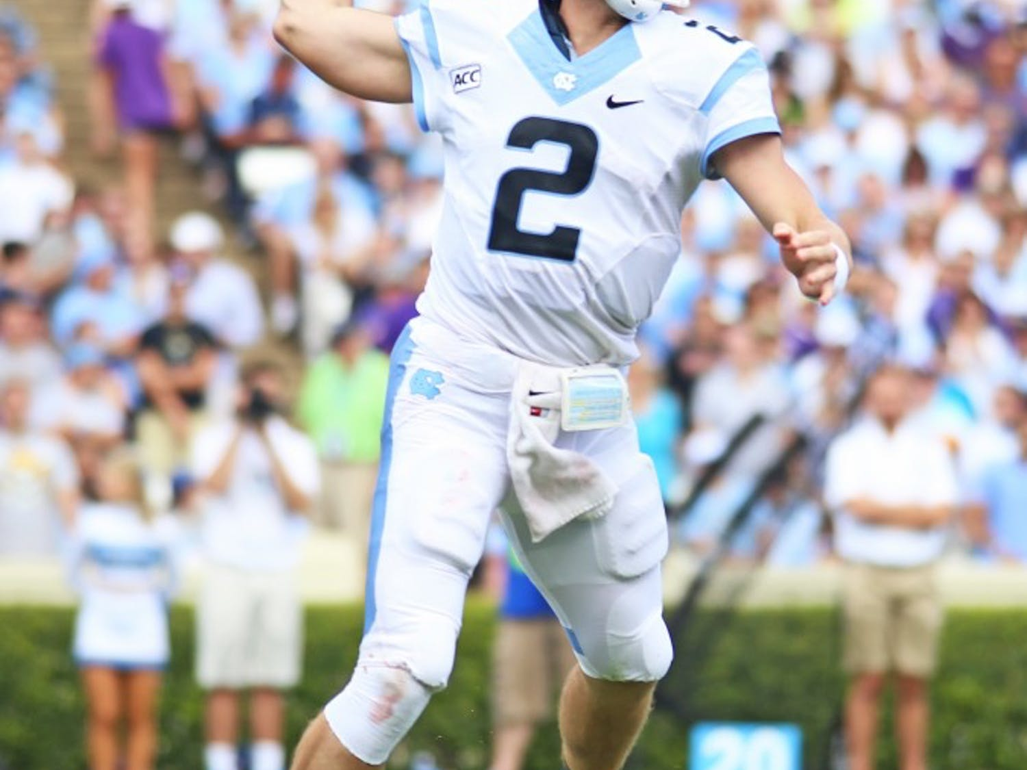 UNC quarterback Bryn Renner (2) threw for a career high 366 yards, and also passed former UNC quarterback T.J. Yates.