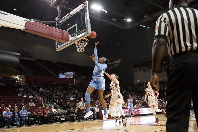 Sophomore forward Jaelynn Murray (30) throws the ball into the basket during the Tar Heel's 100-69 season opener win against Elon University at the Schar Center in Elon, North Carolina Tuesday, Nov. 6, 2018.