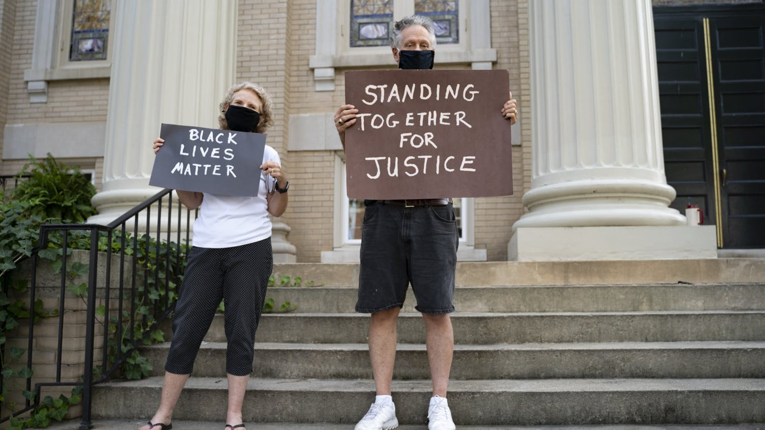 Protestors on the steps of University Baptist Church hold signs in support for the Black Lives Matter movement on Friday, Aug. 28, 2020, as well as every Friday since July.