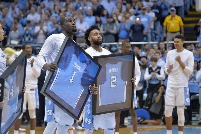 Theo Pinson (left) and Joel Berry II (right) receive framed jerseys on UNC's senior night against Miami on Feb. 27 at the Smith Center.