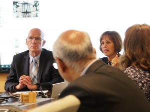 Provost Bob Blouin (left) and Chancellor Carol Folt (right) discuss matters relating to the Confederate monument, Silent Sam, during an executive committee meeting on Monday.