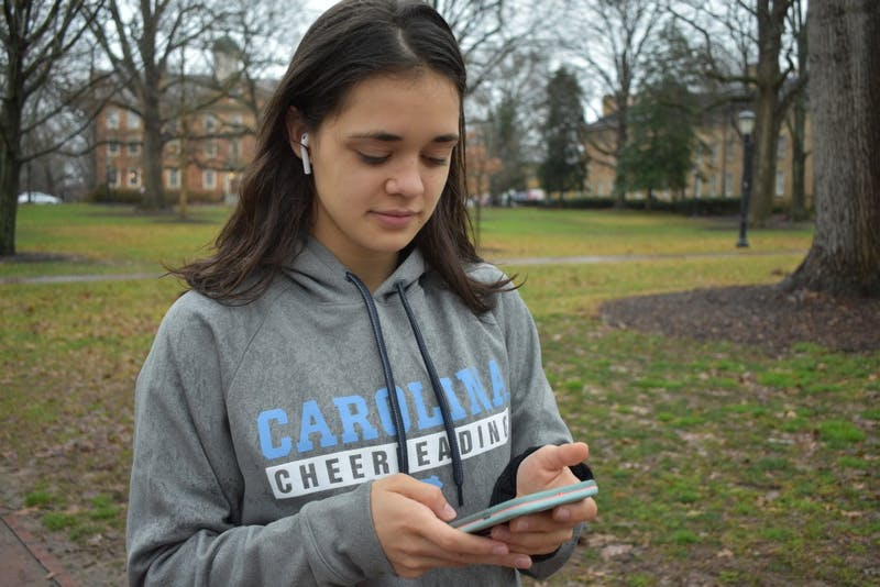 Transfer student, Natalia Aquino, uses her AirPods on her walk to class, despite her preference for Beats Headphones.