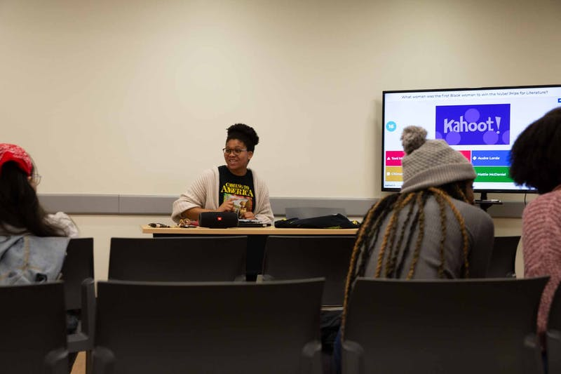 Members of The Bridge play Kahoot! on Thursday, March 5, 2020 during their fourth anniversary. The Bridge serves as a safe pace for many women of color on campus.
