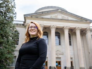 UNC graduate student Sarah Bulger poses for a portrait in front of Wilson Library on April 18, 2021. Bulger is a participant in the UNC Story Archive project based in the Wilson Special Collections Library.