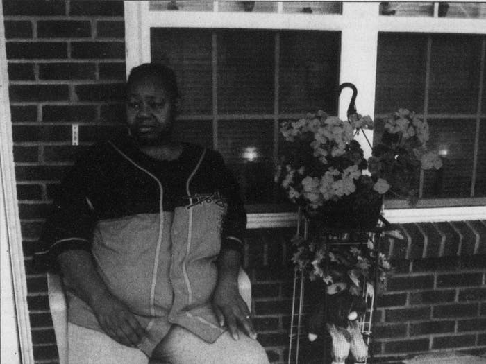 DTH Archive. Gloria Hagans sits on her front porch in Princeville in 2005. Hagans was one of thousands from the area who was displaced by the flooding caused by Hurricane Floyd in 1999. Photo by Isaac Sandlin.