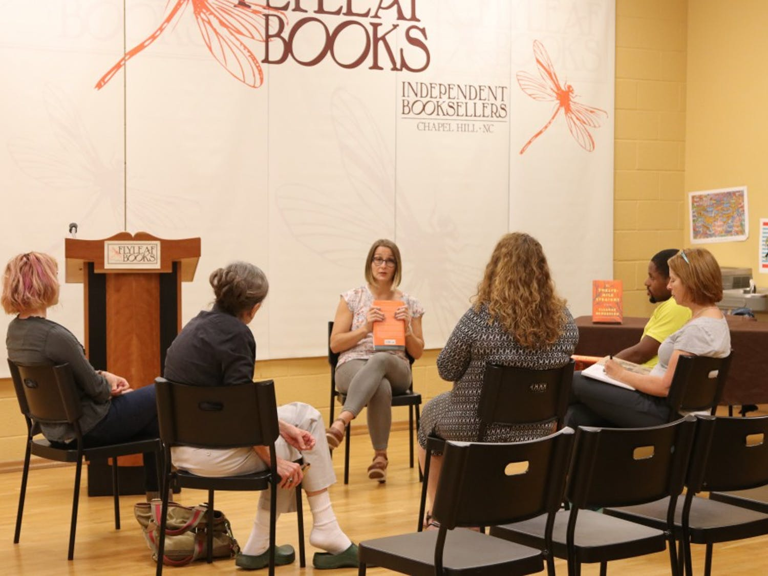 Eleanor Henderson sits with five others hosting a Q&A on Wednesday night at Flyleaf books.