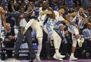 The North Carolina bench erupts in celebration after guard Kanler Coker (13) made a reverse layup against Texas Southern in the first round of the NCAA Tournament on Friday in Greenville.
