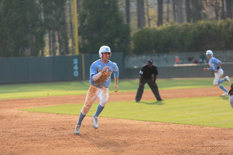 Brian Miller (5) runs toward third base.