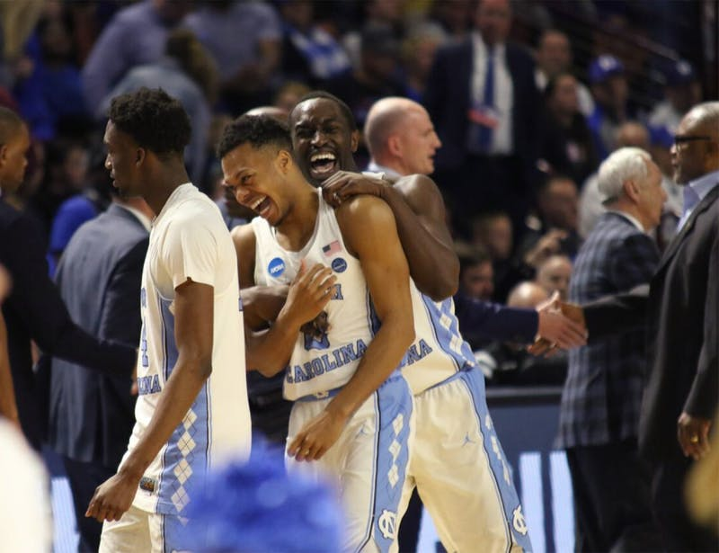 North Carolina wing Theo Pinson (1) and guard Nate Britt (0) celebrate after defeating Arkansas in the second round of the NCAA Tournament in Greenville on Sunday. Trailing 65-60 with 3:28 left, UNC closed the game on a 12-0 run to beat Arkansas.