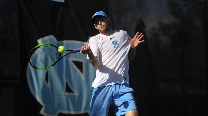 UNC men's tennis junior Josh Peck prepares to return a hit in a singles match against the University of Oklahoma at Cone-Kenfield Tennis Center on Friday, Mar. 22, 2019. The No. 11 UNC men's tennis team beat No. 20 Oklahoma 4-1.