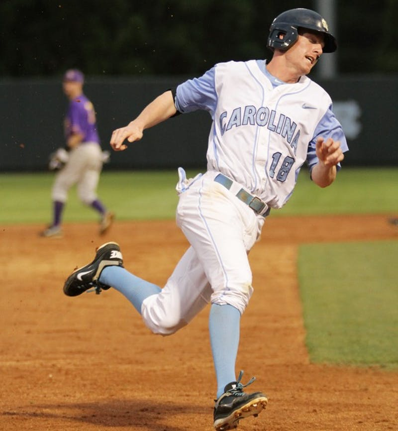 Third Baseman Colin Moran takes third and scores in the fourth inning. The Tar Heels defeated the ECU Pirates 5-3 on April 12.