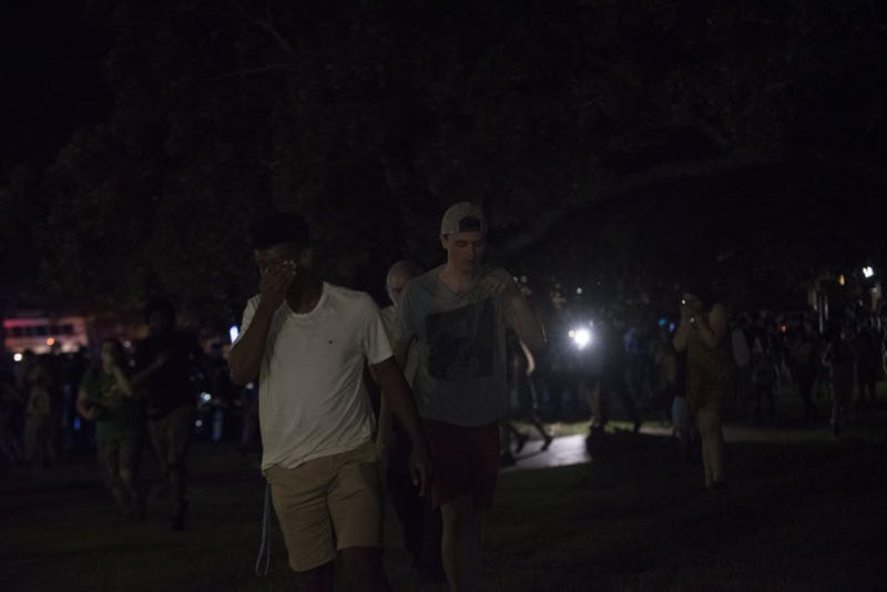 Demonstrators exit Morehead Planetarium parking lot after gas was released on Thursday night.