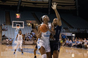 UNC first-year forward Malu Tshitenge (21) aims for the basket with CSU senior center Jasmine Blackmon (44) on defense. The Tar Heels beat the Buccaneers 85-54 on Friday, Nov, 15, 2019 at Carmichael Arena.