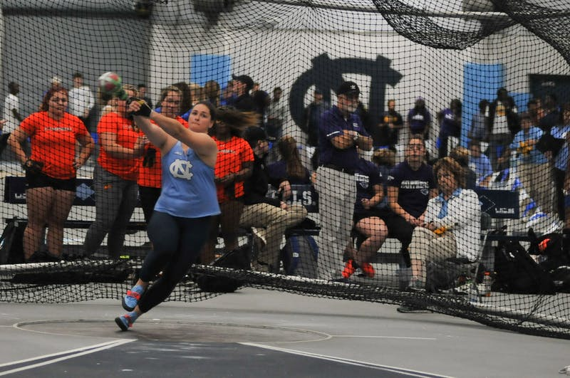 Junior Jill Shippee attempts her second throw in the women's weight throw. Shippee won the overall event by almost five meters in Eddie Smith Field House on Saturday, Jan. 11, 2020.