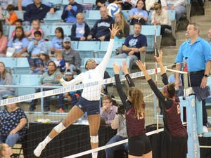 First-year outside hitter Destiny Cox (1) prepares to strike the ball during the Wednesday, Nov. 21, 2018 game against FSU. UNC lost the game 3-0.