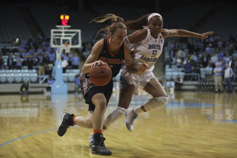 Sophomore guard Stephanie Watts (5) defends against a Bucknell player.