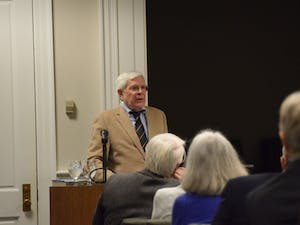 """Howard E. Covington Jr. speaks on past presidents at UNC, based off his book: """"Fire and Stone: The Making of the University of North Carolina Under Presidents Edward Kidder Graham and Harry Woodburn Chase"""", at Wilson Library on Tuesday, Feb. 19, 2019."""